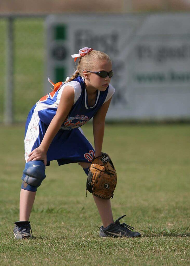 Child playing sports wearing special glasses to protect prosthetic eye from injury